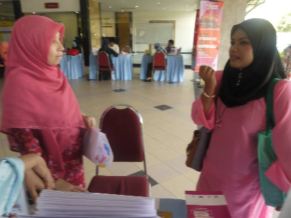 One of the visitors asking question about cancer to Staff Nurse (left)