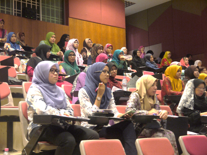 Participants focus on the lecture delivered by speaker